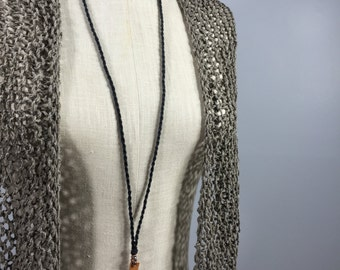 Wearable Fiber Art-Handmade Black Linen Cord holding a Leather Strip Holding Copper and Textured Silver Dangle-a tiny quiet
