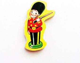 Toy Soldier Brooch - Lapel Pin / Upcycled 1960s Hand Cut Wood Puzzle Piece / Red Coat Soldier / Red Yellow Black / Unique Gift Under 20