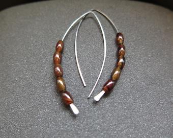 large hypoallergenic earrings. niobium jewelry. copper agate stones. splurge