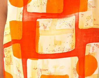 The Vintage Orange Sleeveless Graphic Dress