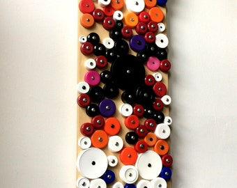Rainbow bottlecap assemblage / wall hanging