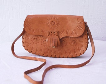70s tooled leather bag. fringed bag. small saddle bag