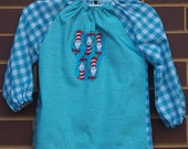 Toddler's long sleeve aqua waterproof art smock, age 2 to 3 years. Cat in the Hat.
