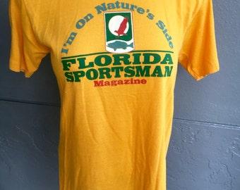 I'm With Nature Florida Sportsman Magazine - 1980s soft vintage yellow tee shirt size small/medium
