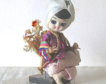 Vintage Big Eye Bradley Doll Seated Asian Oriental Flower Basket
