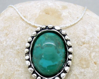 Turquoise necklace set in silver circles
