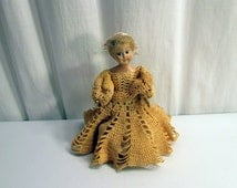 1950s Vintage Rubber Band Doll. 7 Inches Tall. Hand Crocheted Dress. Black Plastic Panties. Moveable Arms and Head. Mid-Century Small Doll