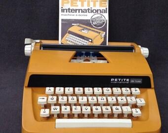 Retro vintage Petite International de luxe typewriter. Stunning French AZERTY ocher orange office desk supply tool.