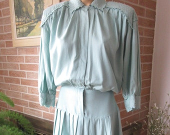 1980's Vintage Drop Waist Pleated and Beaded accent Dress with Shoulder pads.