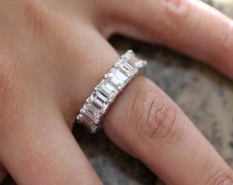 Platinum eternity diamond emerald cut diamond wedding band.