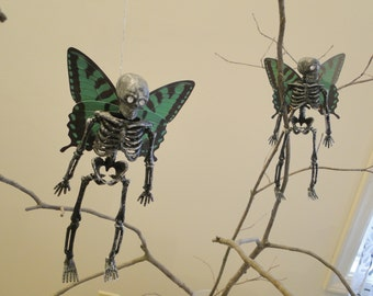 Vintage Dead Deva fairy skeleton with butterfly wings simple unique nature fantasy