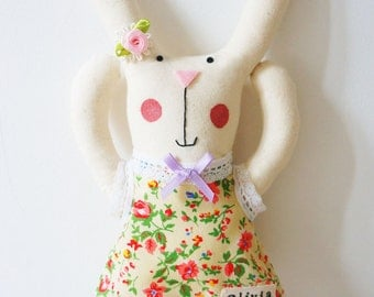 handmade bunny rabbit ar doll with floral dress and personalised name tag.