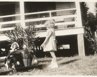 "Vintage Snapshot - ""Dolly Drives the Pedal Car"" - Cute Little Girl Plays with her Doll and Pedal Car - Found Vernacular Photo"