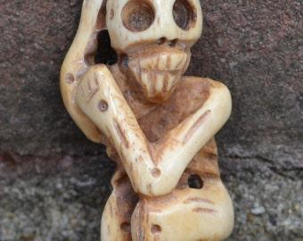 Dancing bones -- skeleton pendant in yak bone  OB106