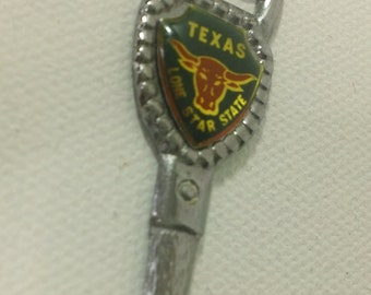 Vintage Texas: Lone Star State souvenir Digging Shovel Collector Spoon with Texas Longhorn graphic