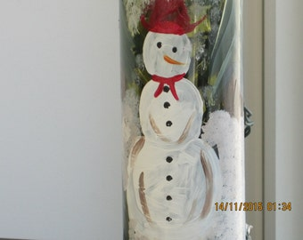 Green Wine bottle with red hat, red scarf Snowman hand painted in snow and evergreens . White lights inside the bottle. ingeborgsorgent