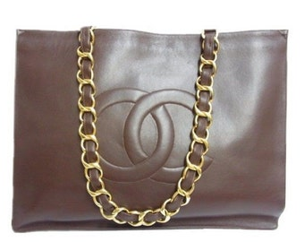 Vintage CHANEL brown calfskin large tote bag with gold tone chain handles and CC motif. Classic purse for daily use