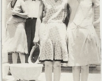 Old Photo Women wearing Dresses People in background wearing Hats Round Glasses 1920s Photograph Snapshot vintage