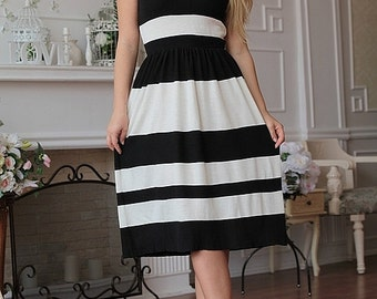 """Knitted viscose dress """"Striped flight"""" in classic black and white colors, good choice for the office. Midi dress"""