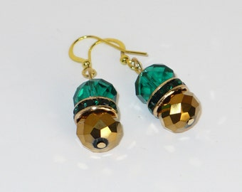 Deep rich teal and gold glass bead dangle earring with teal rhinestone rondelle.