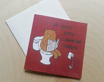 "CARD: ""A Good Poop Makes Me Happy"" featuring a relaxed cat on the toilet"