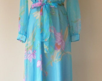 Seventies long soft blue designer boho dress with flower print by Vera Mont Paris. Eu 40