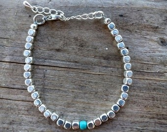 Bright Silver Cubed Beads with a touch of Turquoise Bracelet