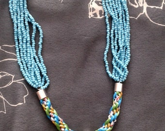 Handmade Kumihimo braid necklace with seed bead pendant.