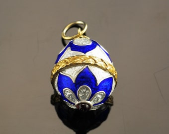 Blue and White Faberge Egg Pendant with Garnet