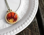 Vintage Cross Stitch Necklace. Orange Red Yellow Floral Hand Stitched Embroidery Hoop Pendant. Wood Hoop Fiber Art Jewelry. Gifts under 30.
