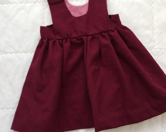Vintage baby/toddler maroon/dark red pinafore dress with button detail. Approx size 0/ 1.