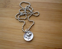 CTR concave necklace with a small heart charm, perfect for a LDS Baptism gift.