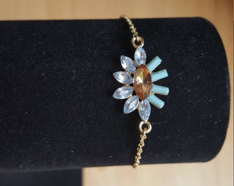 Gold bracelet with crystal pendant