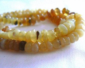 Yellow opal gemstone rondelle 4mm beads. Strand 4in. Gemstone supply. Jewelry beads supply. Yellow opal