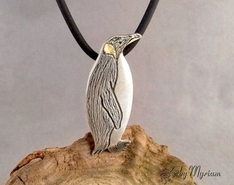 Emperor penguin pendant in fine silver with invisible bail . Hand cut & carved silver penguin necklace