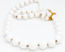 Elegant vintage signed Monet graduated white plastic bead necklace with gold tone spacer beads, 1960s 1970s nautical summer perfect jewelry