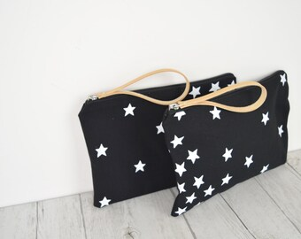 LAST PIECE! handprinted fabric clutch with white stars on black fabric