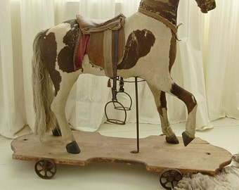 Beautiful antique rocking horse, pull toy, 1870, real fur, glass eyes....CHARMANT!