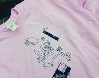 hand-printed/handmade t-shirts with Japanese text and an original design