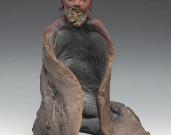 Red Faced Bodhidharma Sculpture With a Raw Clay Raku Robe and Fierce Gaze