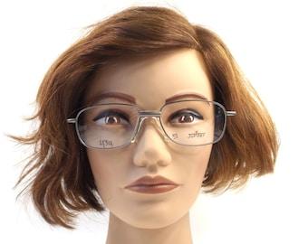 deadstock eyeglasses. 90s vintage. gunmetal. pewter color. black plastic. eye glasses. eyeglasses frames. 1990s. eyeglasses frames. men. 117