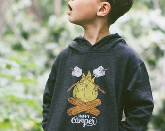 Happy Camper Vintage Kids Hoodie. Unisex Black Toddler Triblend Sweatshirt with campfire and marshmallows. Celebrates Wilderness.