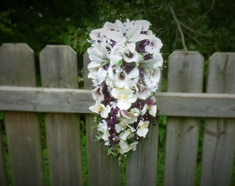 Cascading bridal bouquet with picasso calla lilies, lilies, orchids, plum hydrangeas, pearl accent, plum and ivory bouquet
