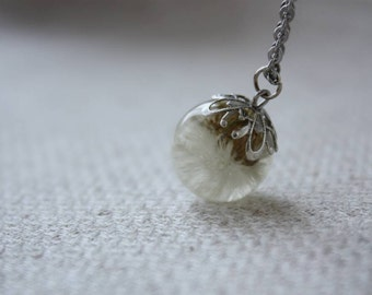 Pendant with real small dandelion