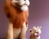 The pride of a pride: lion-farther and a young lion-son