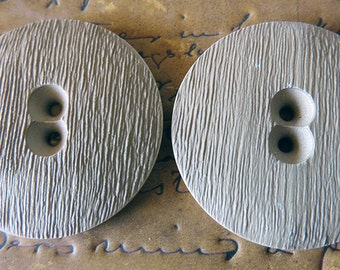 Set of two large flat mat beige rough surfaced two hole vintage buttons
