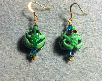 Bright blue and green frog lampwork earrings adorned with blue Czech glass beads.