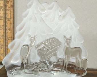 Christmas manger nativity scene with deer glass frosted glass votive candle holder beautiful shadows backlit from behind