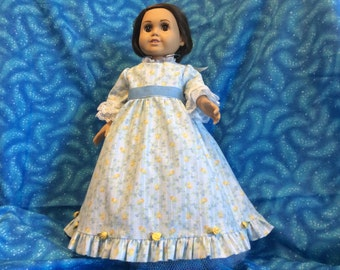 American girl doll old fashioned dress and net petticoat. Yellow satin roses at ruffled hem, blue velvet sash, lace at neck and sleeves