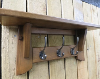 Hat and coat rack with shelf. 3 hooks.